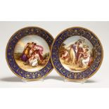 A GOOD PAIR OF VIENNA PORCELAIN PLATES,rich blue gilt borders, the centres painted with classical