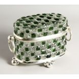 A CUT GLASS OVAL CASKET with ring handles