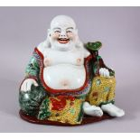 A CHINESE PORCELAIN BUDDHA, holding a scepter.