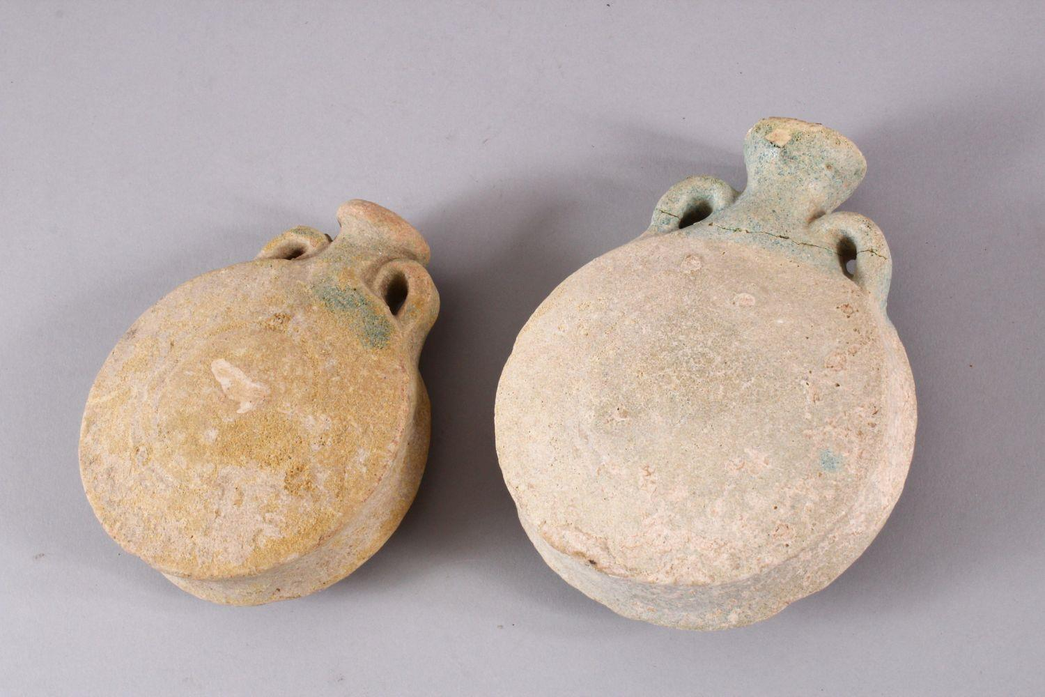TWO 10TH CENTURY IRANAIN POTTERY TWIN HANDLE BOTTLES, each with traces of turquoise glaze to the - Image 2 of 2