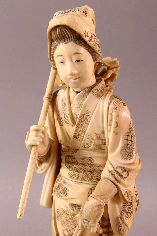 A LARGE JAPANESE MEIJI PERIOD CARVED IVORY OKIMONO - FARMER - the large okimono depicting a female - Image 2 of 11