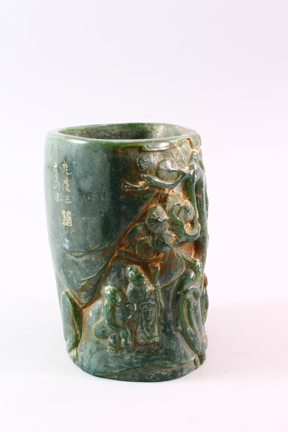 A CHINESE GREEN HARDSTONE BRUSH POT, carved with figures and trees, calligraphy, 15.5cm high. - Image 2 of 7