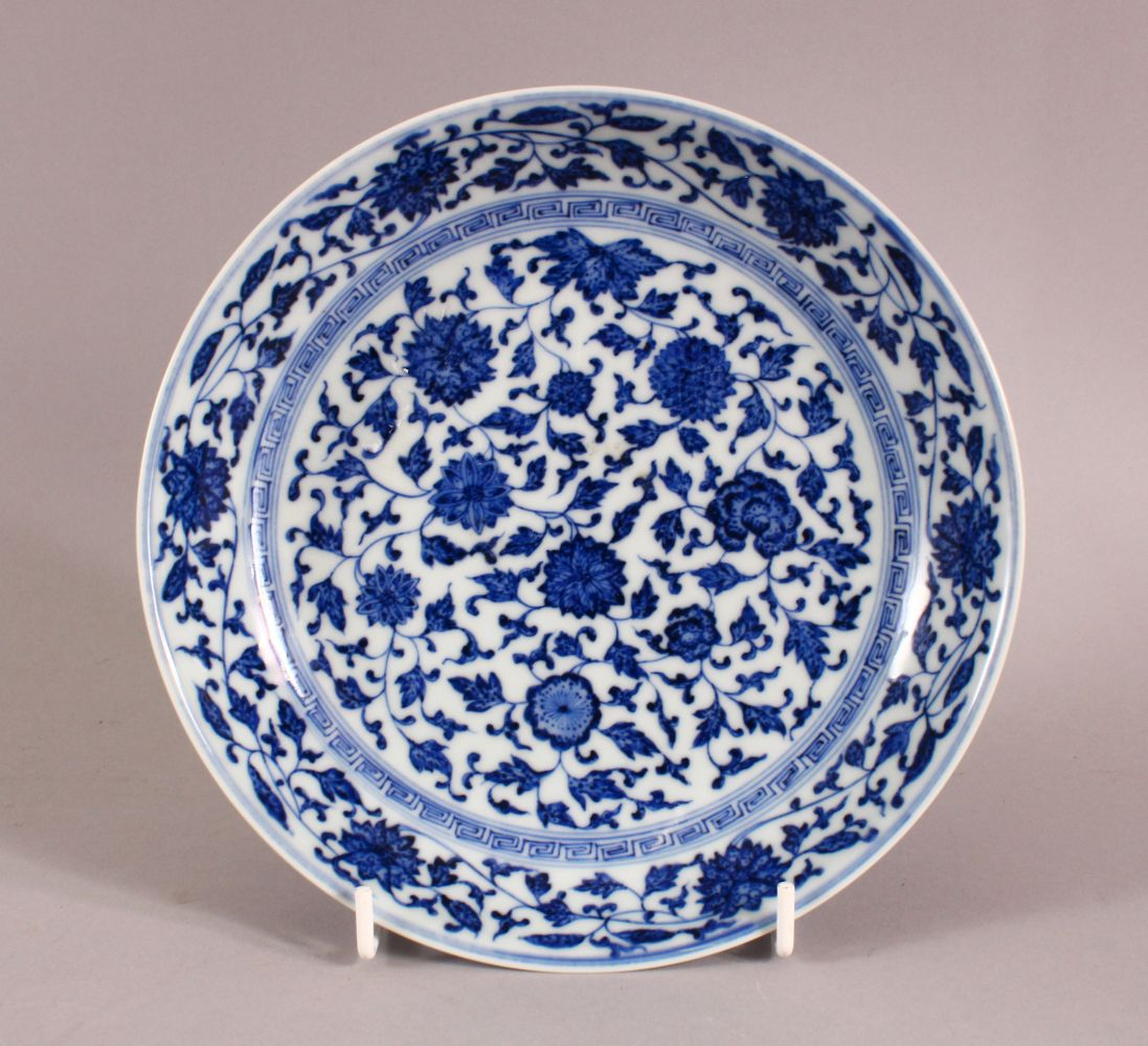 A CHINESE BLUE & WHITE PORCELAIN LOTUS DISH, decorated with sprays of lotus, the underside with a