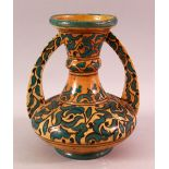 A MOROCCAN POTTERY FLORAL VASE - SIGNED BY BIN JALAL, with twin handles and green foliage
