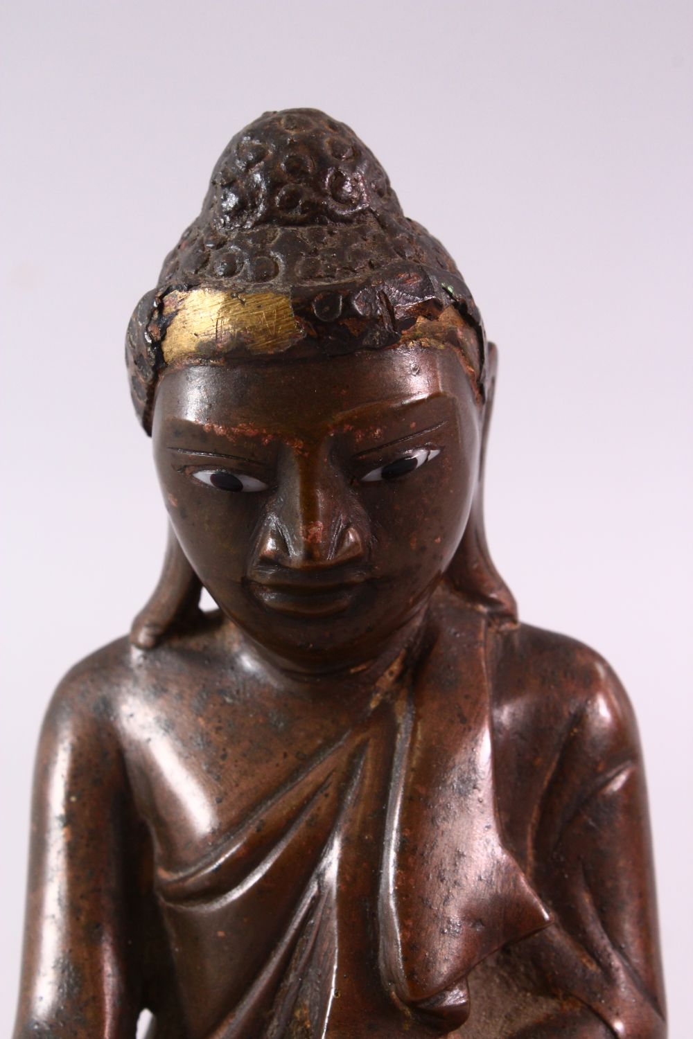 A BRONZE BUDDHA with glass inset eyes, 16cm high. - Image 2 of 6