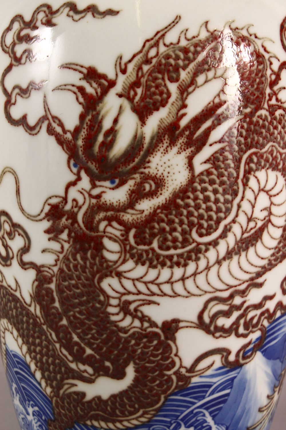 A LARGE CHINESE UNDERGLAZE BLUE & COPPER RED PORCELAIN VASE, decorated with dragons amongst waves, - Image 2 of 7