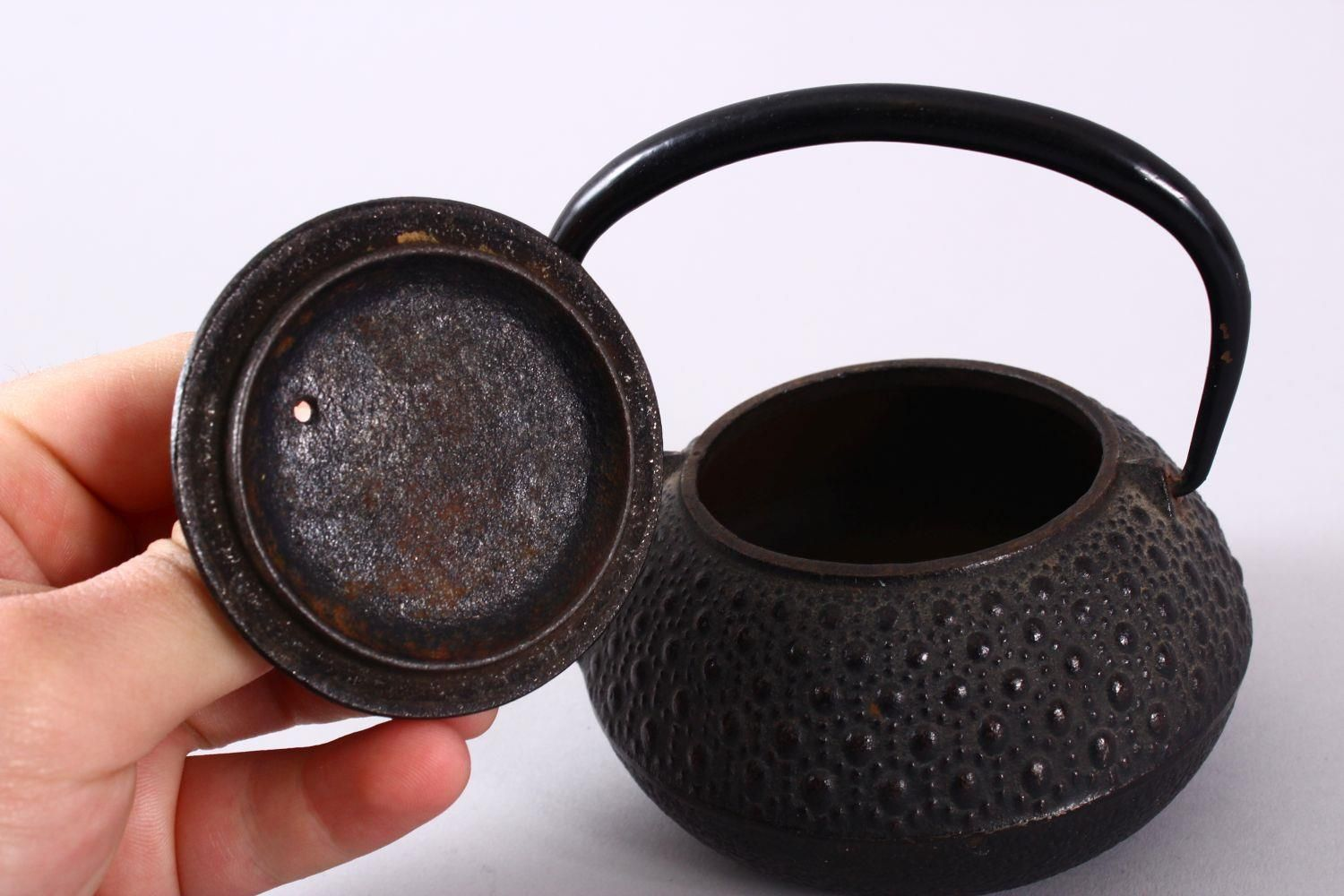A JAPANESE IRON / METAL MOULDED TEAPOT & COVER, the body with moulded stud decoration, possibly iron - Image 4 of 5