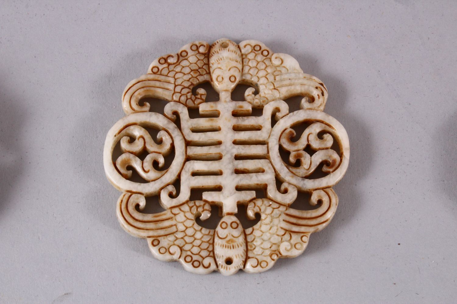 THREE CHINESE CARVED JADE PENDANTS, One carved in the form of TWIN BATS AND SYMBOLS, 6.5cm, one - Image 3 of 5