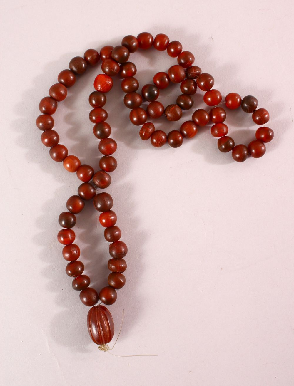 A RHINO HORN BEAD NECKLACE, beads approx 10mm diameter, weight 65g.