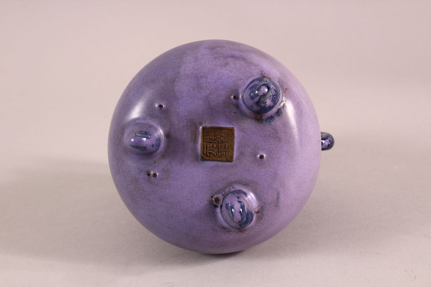 A CHINESE SONG STYLE AUBERGINE GLAZE WINE POT, with tripod feet, the base with a mark, 13cm high. - Image 5 of 6