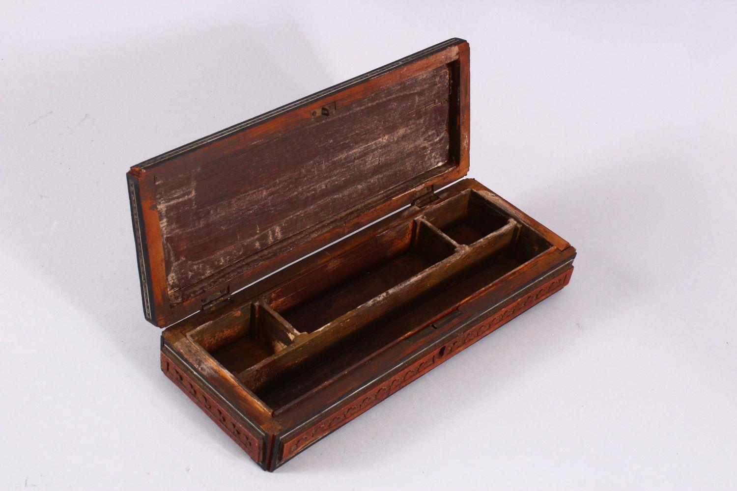 A 19TH / 20TH CENTURY INDIAN CARVED WOODEN BOX, carved with temples, animals and foliage, with - Image 3 of 4