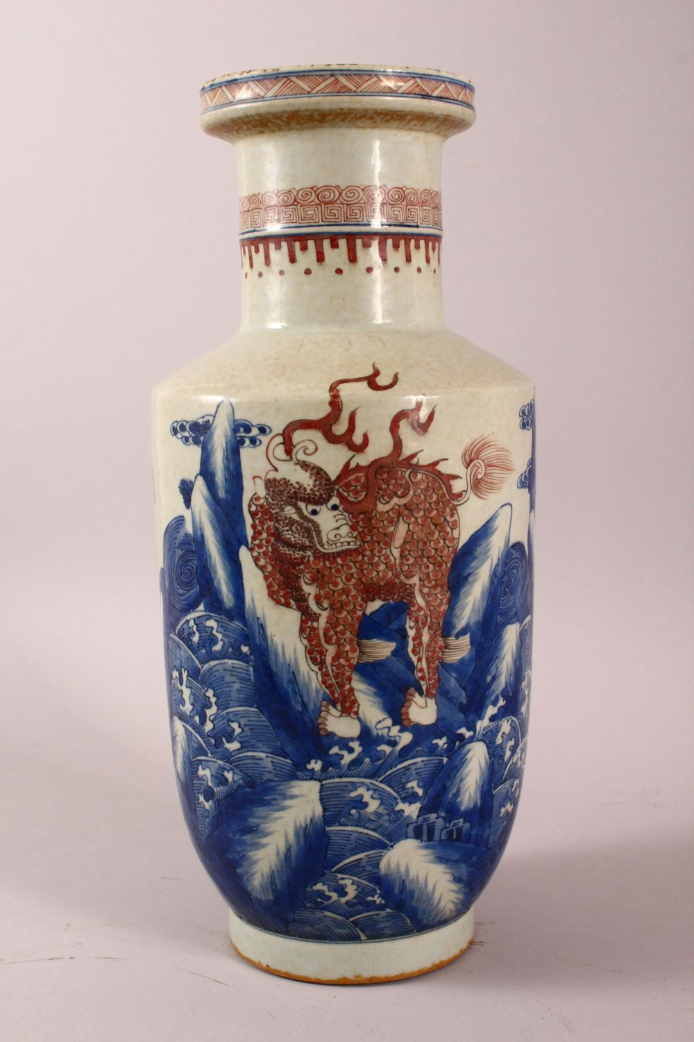 A CHINESE UNDERGLAZE BLUE & COPPER RED PORCELAIN VASE, decorated with lion dogs and waves, six - Image 2 of 8