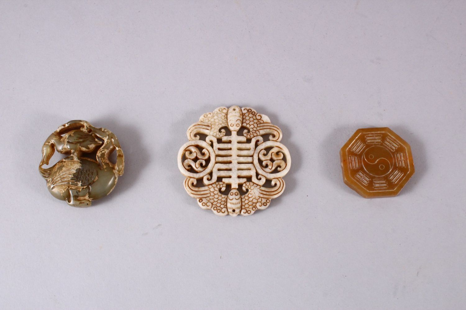 THREE CHINESE CARVED JADE PENDANTS, One carved in the form of TWIN BATS AND SYMBOLS, 6.5cm, one - Image 5 of 5