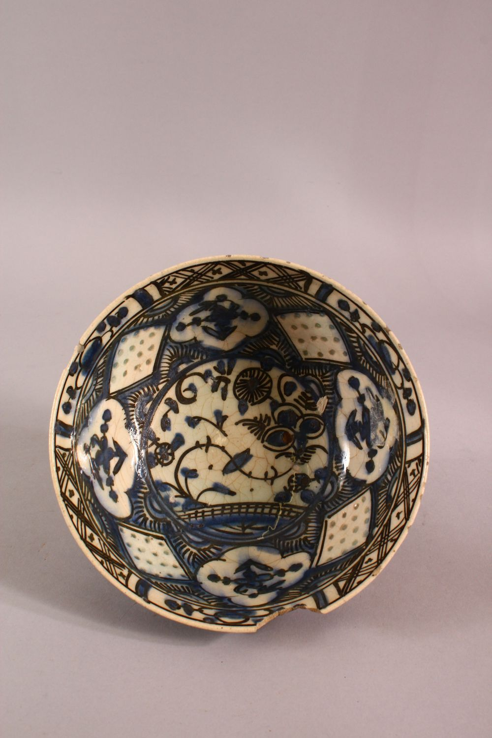 A 19TH CENTURY OR EARLIER TURKISH POTTERY BOWL, with floral motif decorations, (af) 18.5cm - Image 5 of 6