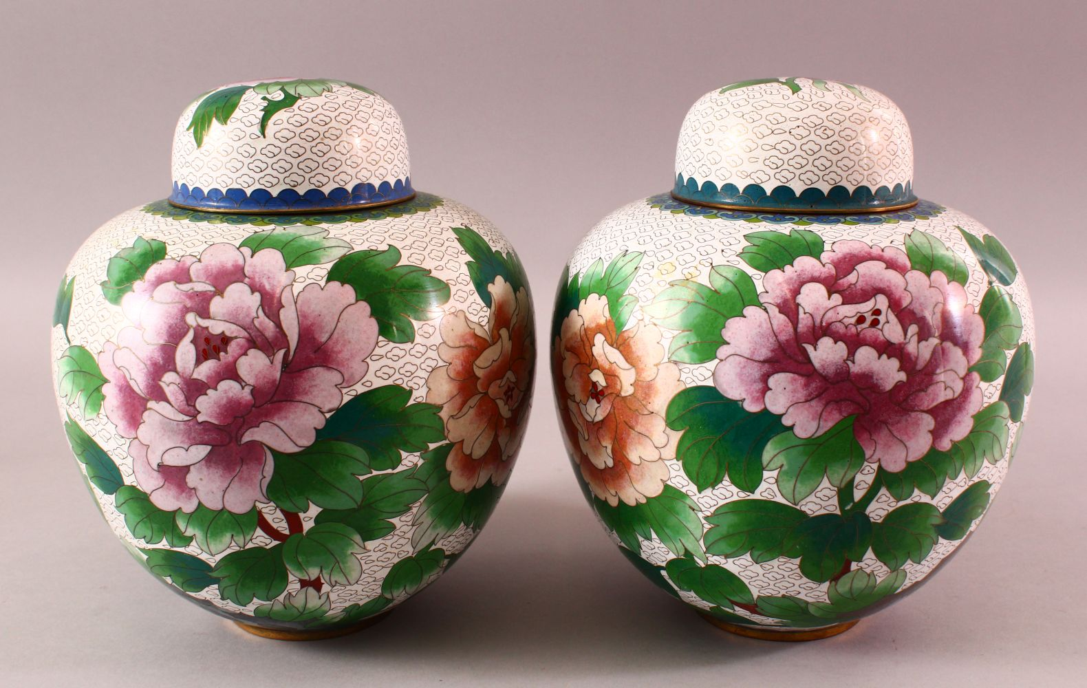 A PAIR OF CHINESE CLOISONNE GINGER JARS & COVERS, each with a white ground and floral decoration,