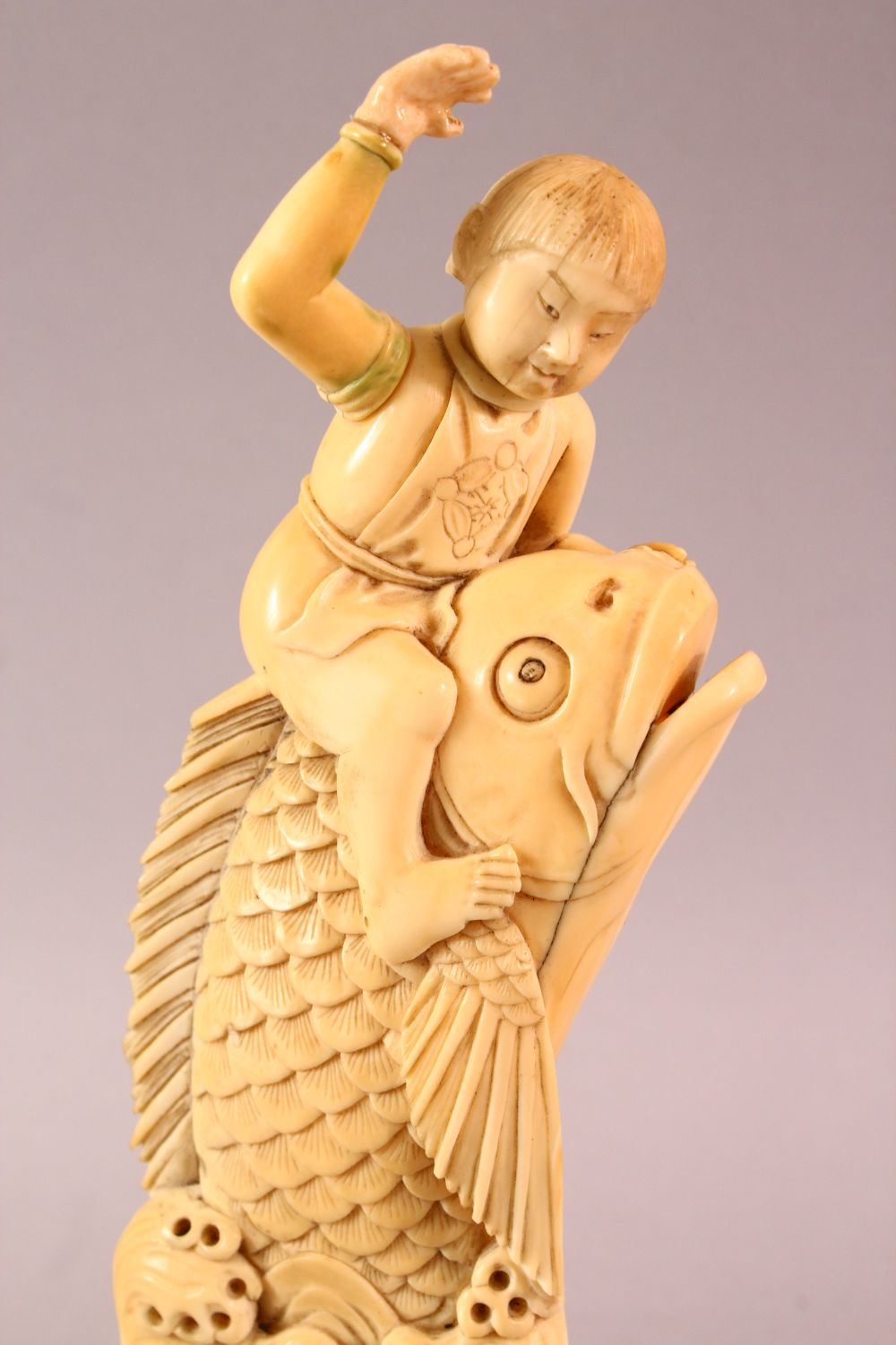 A JAPANESE MEIJI PERIOD CARVED IVORY FISH OKIMONO, the fish emerging from the water with a boy on - Image 2 of 9