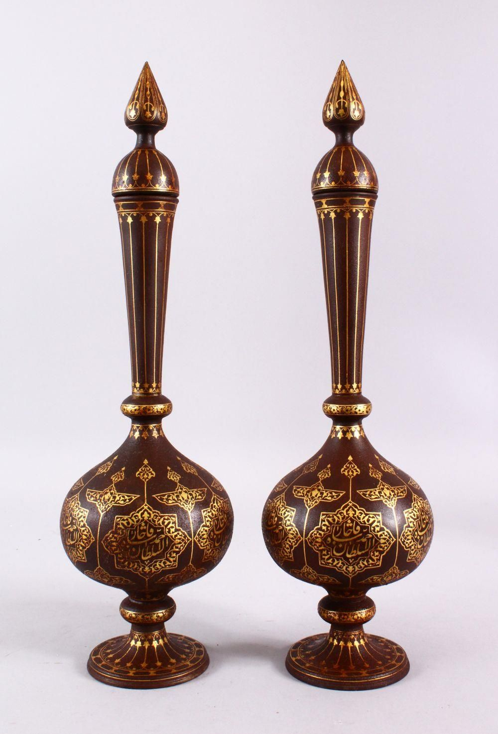 A PAIR OF ISLAMIC DAMASCENE INLAID STEEL BOTTLE & COVERS, each with gold inlaid panels of star