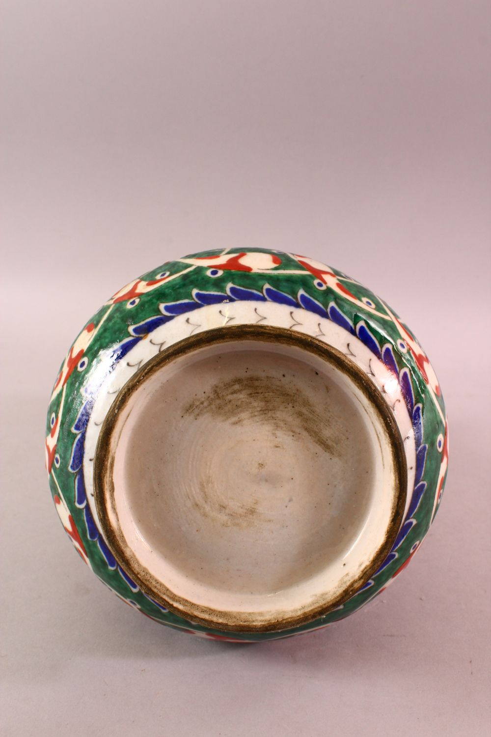 A TURKISH OTTOMAN 18TH CENTURY IZNIK VASE, with green and red motif decorations, 26cm - Image 4 of 4