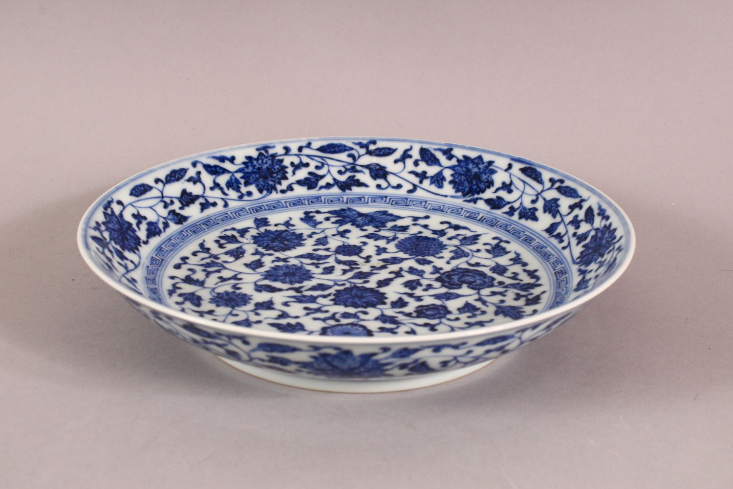 A CHINESE BLUE & WHITE PORCELAIN LOTUS DISH, decorated with sprays of lotus, the underside with a - Image 3 of 5