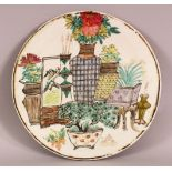 A 19TH / 20TH CENTURY CHINESE FAMILLE ROSE PORCELAIN PANEL, depicting floral display, 28cm