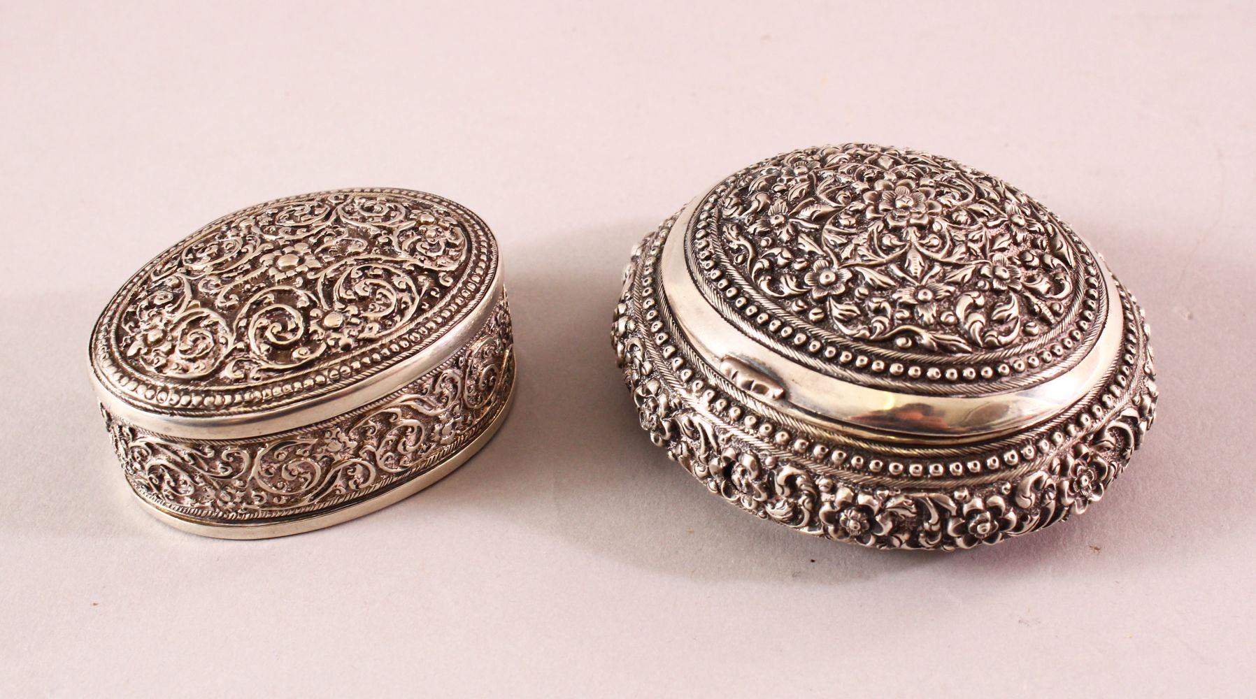 TWO 19TH CENTURY SRI LANKAN SILVER BOXES with filigree decoration, 7.5cm and 5.5cm wide.