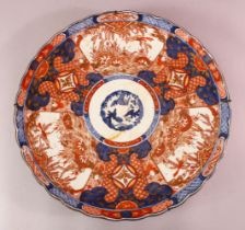A LARGE JAPANESE MEIJI PERIOD IMARI PORCELAIN CHARGER, with panels of birds and foliage with typical