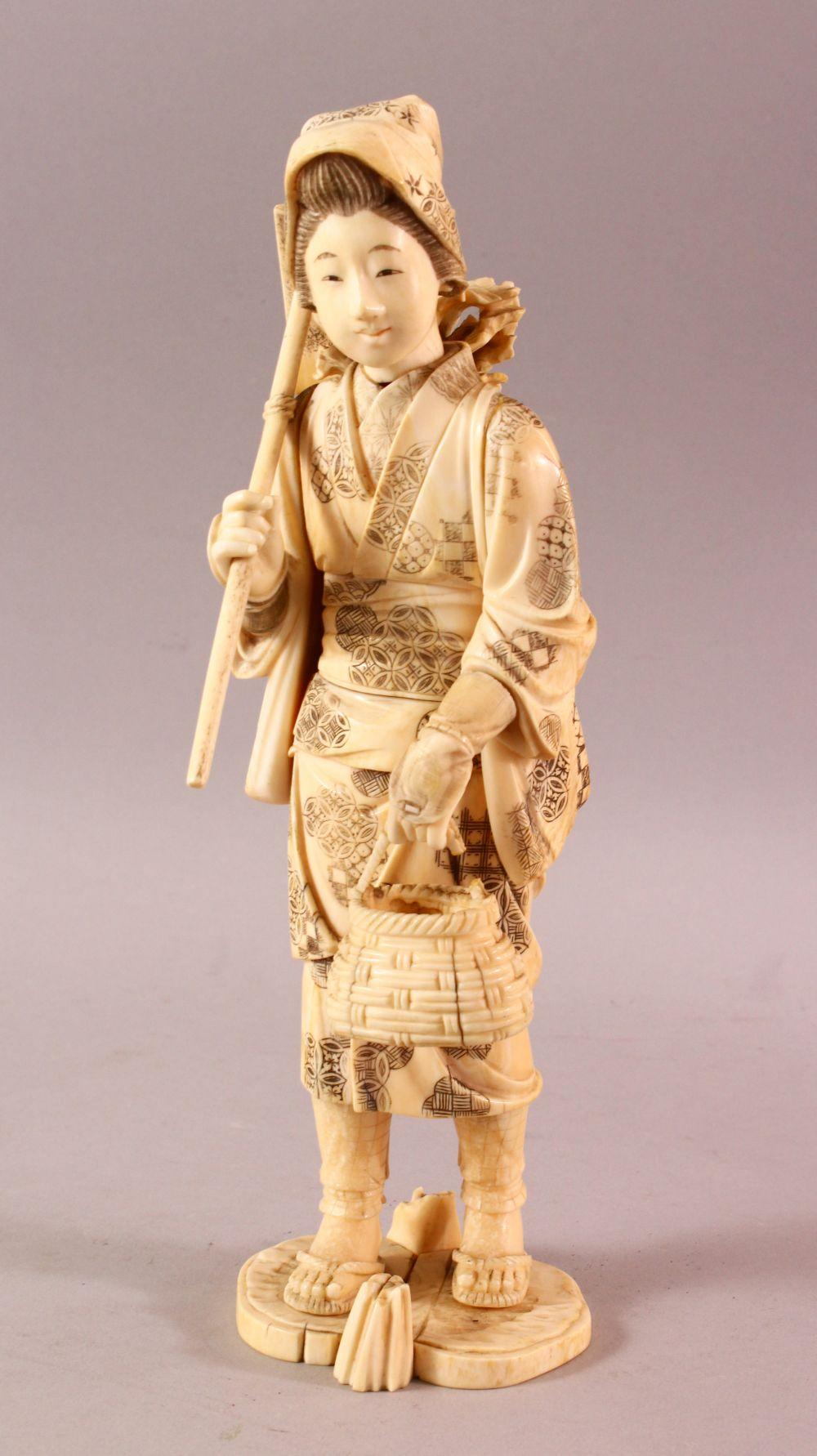A LARGE JAPANESE MEIJI PERIOD CARVED IVORY OKIMONO - FARMER - the large okimono depicting a female