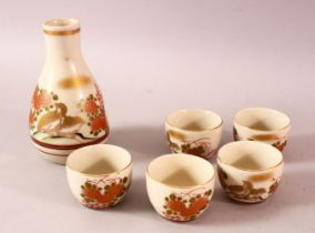 A JAPANESE PORCELAIN SAKE SET, five cups and one bottle, decorated with quail and flora, 13cm the