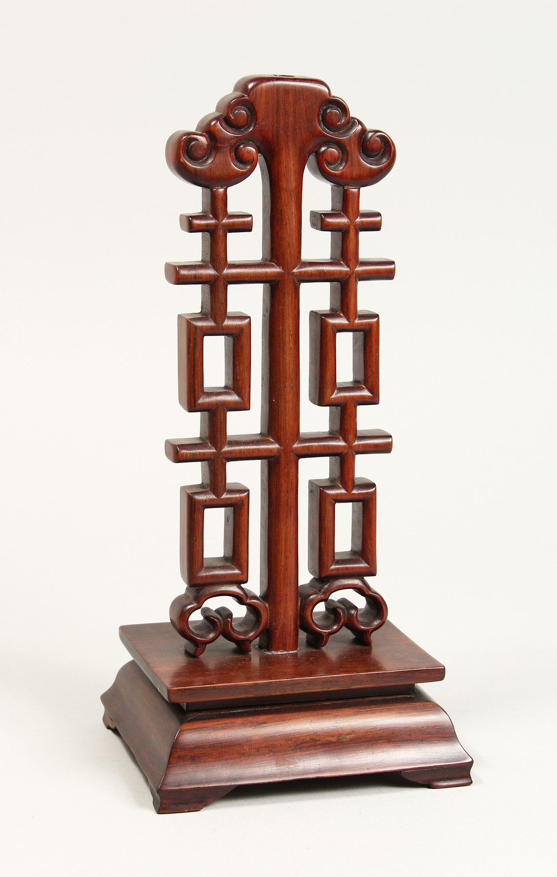 A CHINESE CARVED AND PIERCED WOODEN STAND, 12ins high.