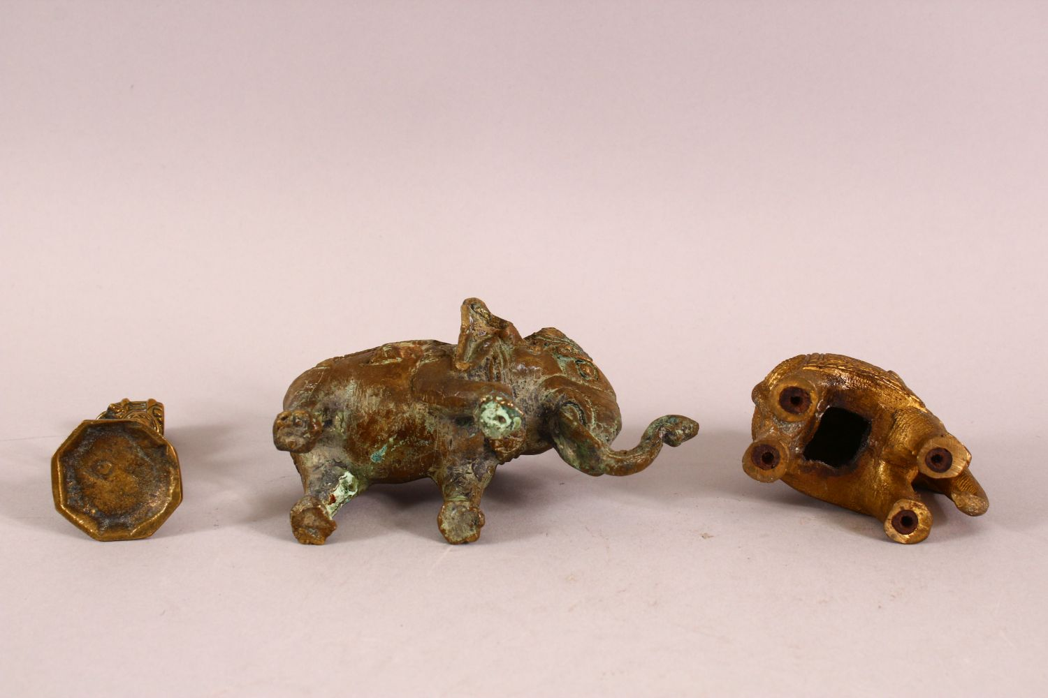 THREE INDIAN GILT METAL FIGURES, two elephant and a figure. - Image 3 of 3
