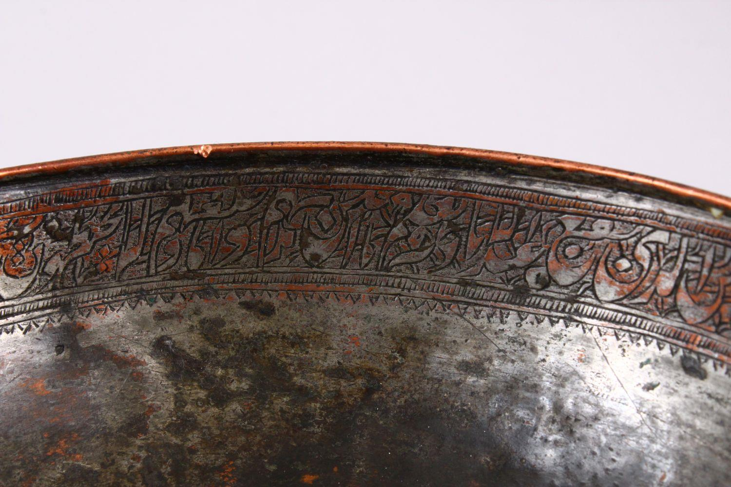 A UNUSUAL ISLAMIC TINNED HAMMERED COPPER CALLIGRAPHIC BOWL, decorated with interior & exterior bands - Image 6 of 8