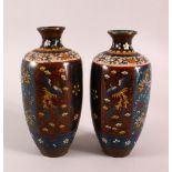 A PAIR OF JAPANESE CLOISONNE VASES, decorated with phoenix, flowers and butterflies, 22cm high.