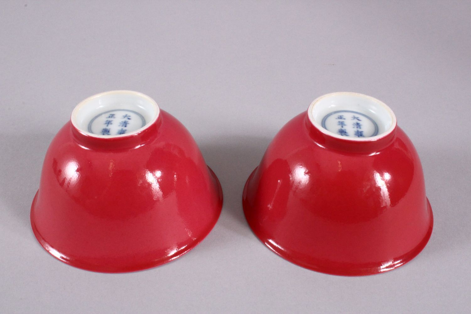 A PAIR OF 19TH / 20TH CENTURY CHINESE RUBY RED GLAZED PORCELAIN TEA BOWLS, with a ruby red / pink - Image 2 of 4