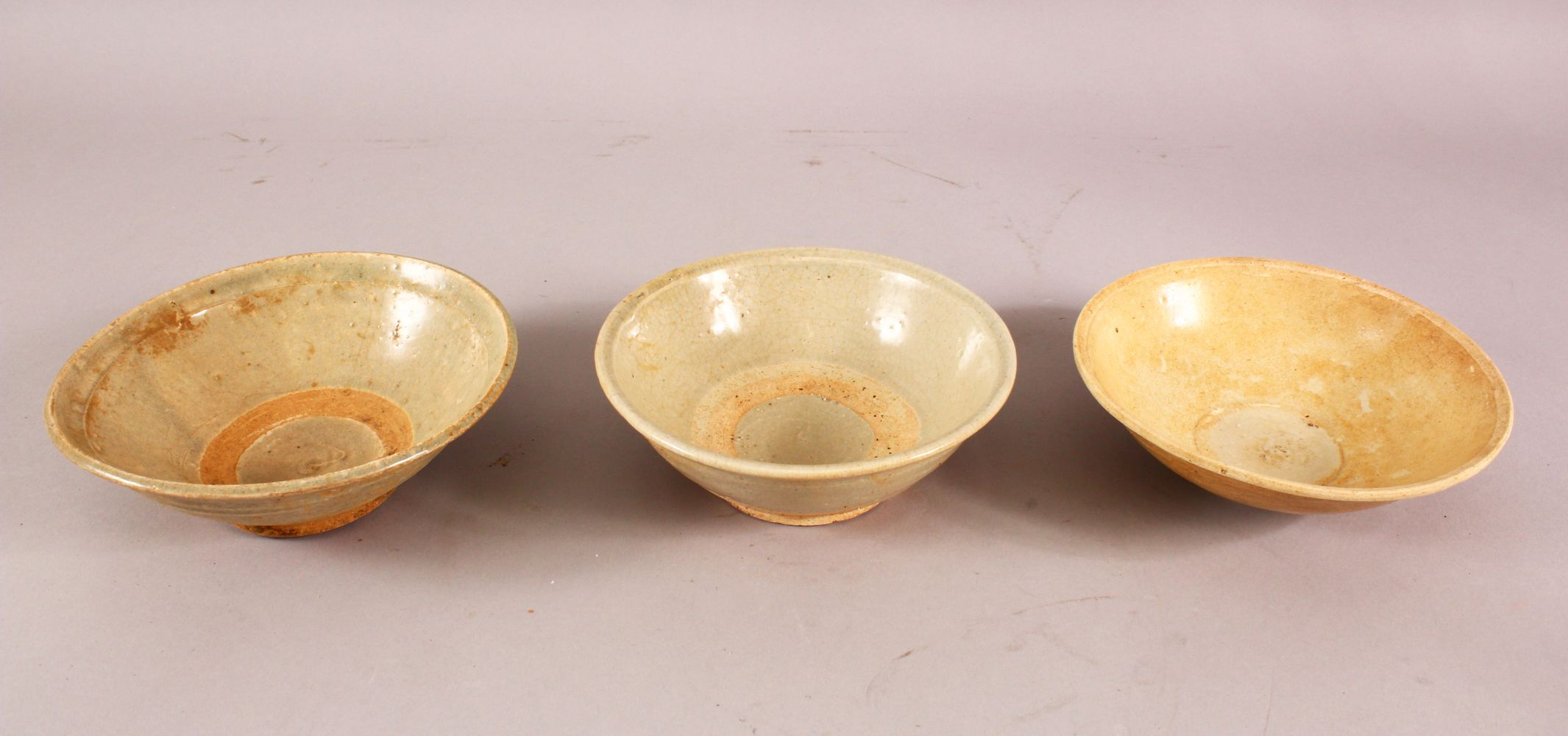 THREE EARLY CHINESE POTTERY BOWLS, of varying style and size (3)