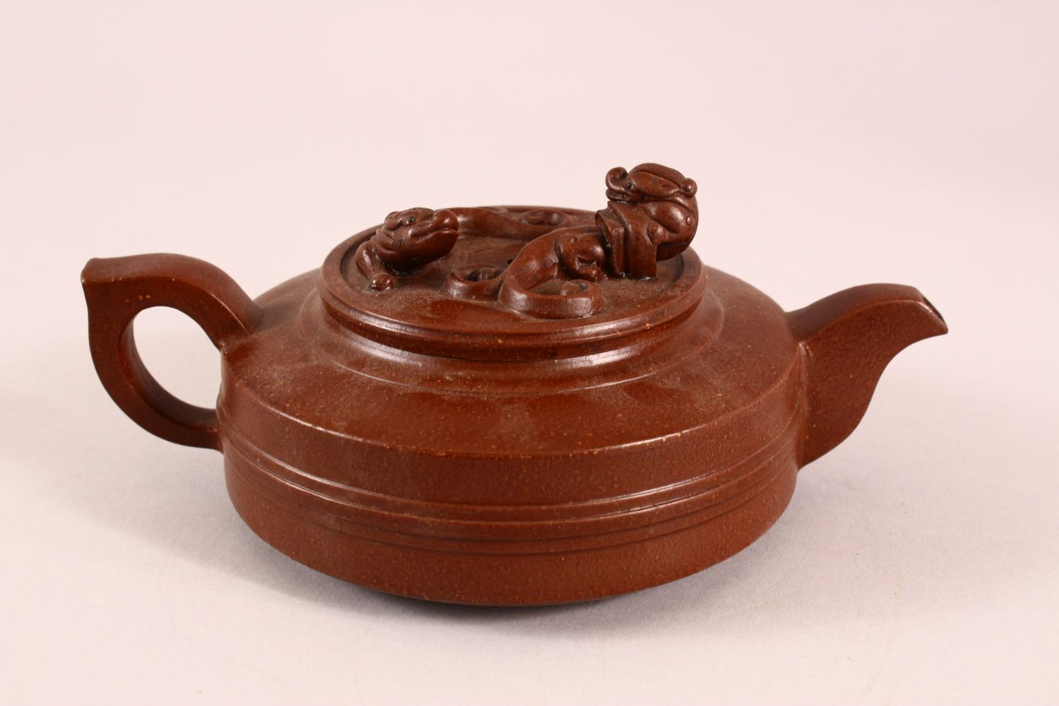 A CHINESE YIXING CLAY TEAPOT, with moulded beast like figures, the underside of the pot and lid with - Image 3 of 8