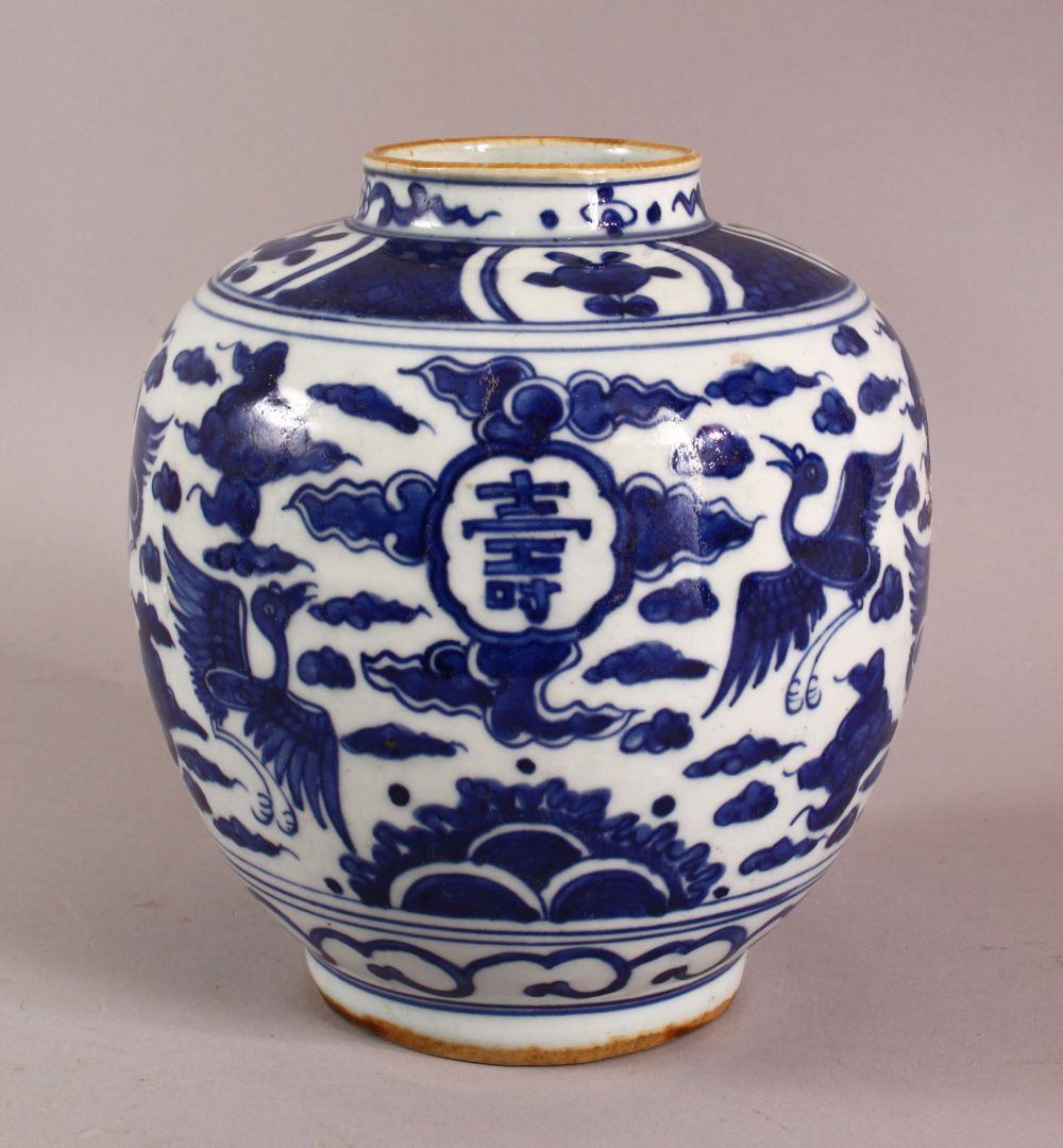 A CHINESE BLUE & WHITE PORCELAIN GINGER JAR, decorated with birds and symbols amongst clouds, rabbit