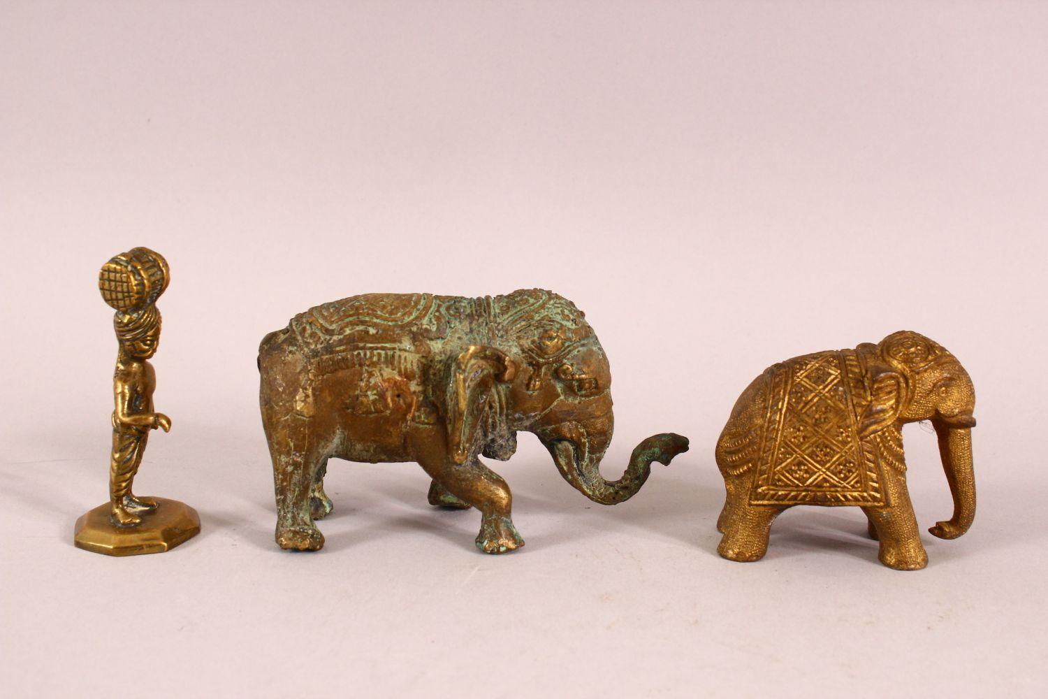 THREE INDIAN GILT METAL FIGURES, two elephant and a figure. - Image 2 of 3