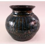 A MAMLUK STYLE POTTERY CALLIGRAPHIC VASE, with a dark blue to black ground with calligraphy bands,