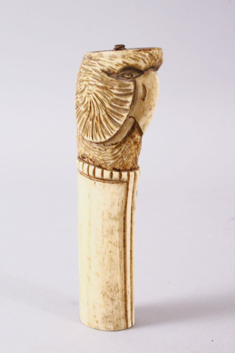 A 19TH CENTURY INDIAN MUGHAL CARVED IVORY BIRD FORMED DAGGER HANDLE, 13cm.
