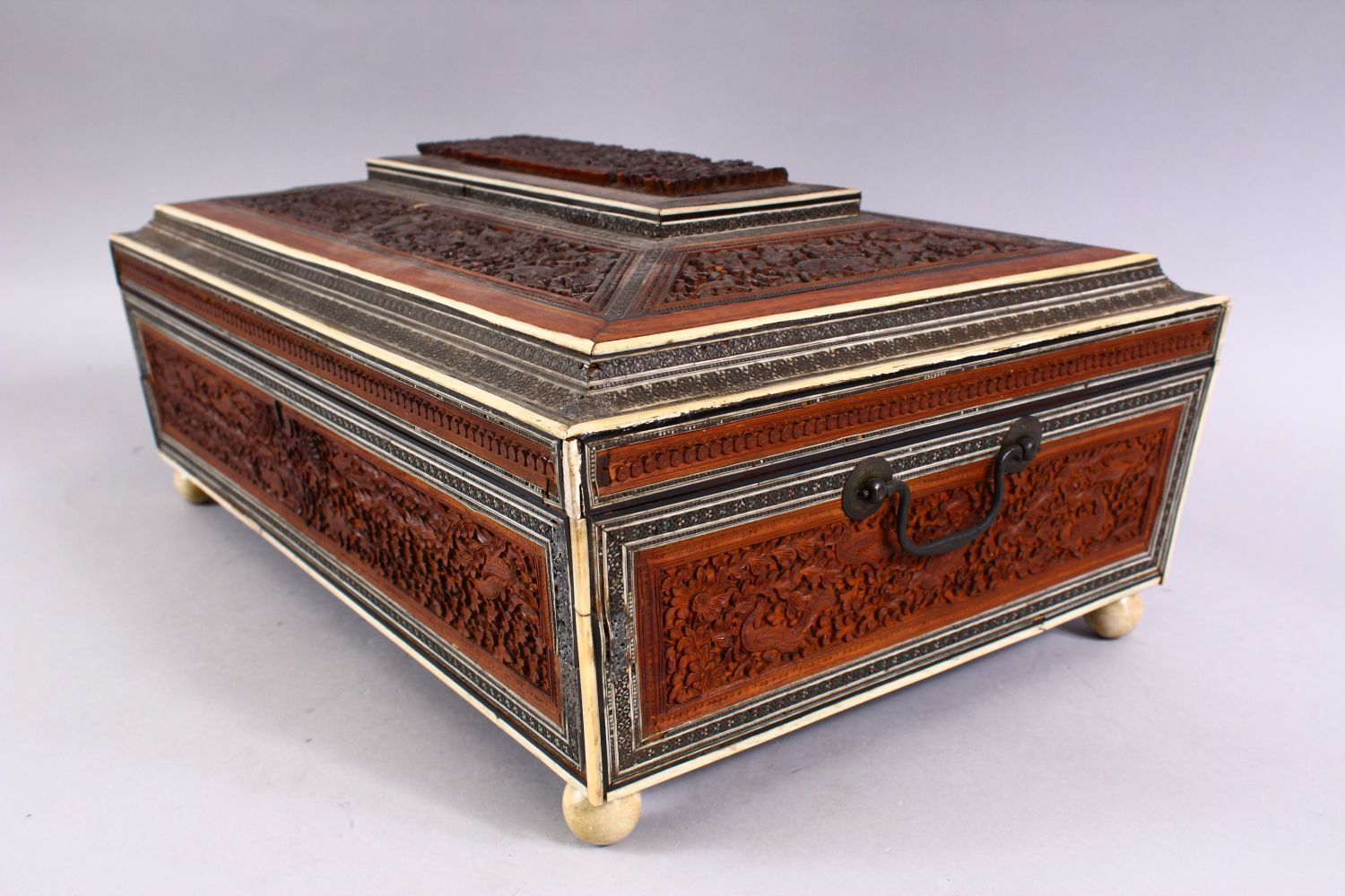 A 19TH CENTURY ANGLO INDIAN INLAID LIDDED SEWING BOX, with carved wood depicting figures and animals - Image 2 of 10