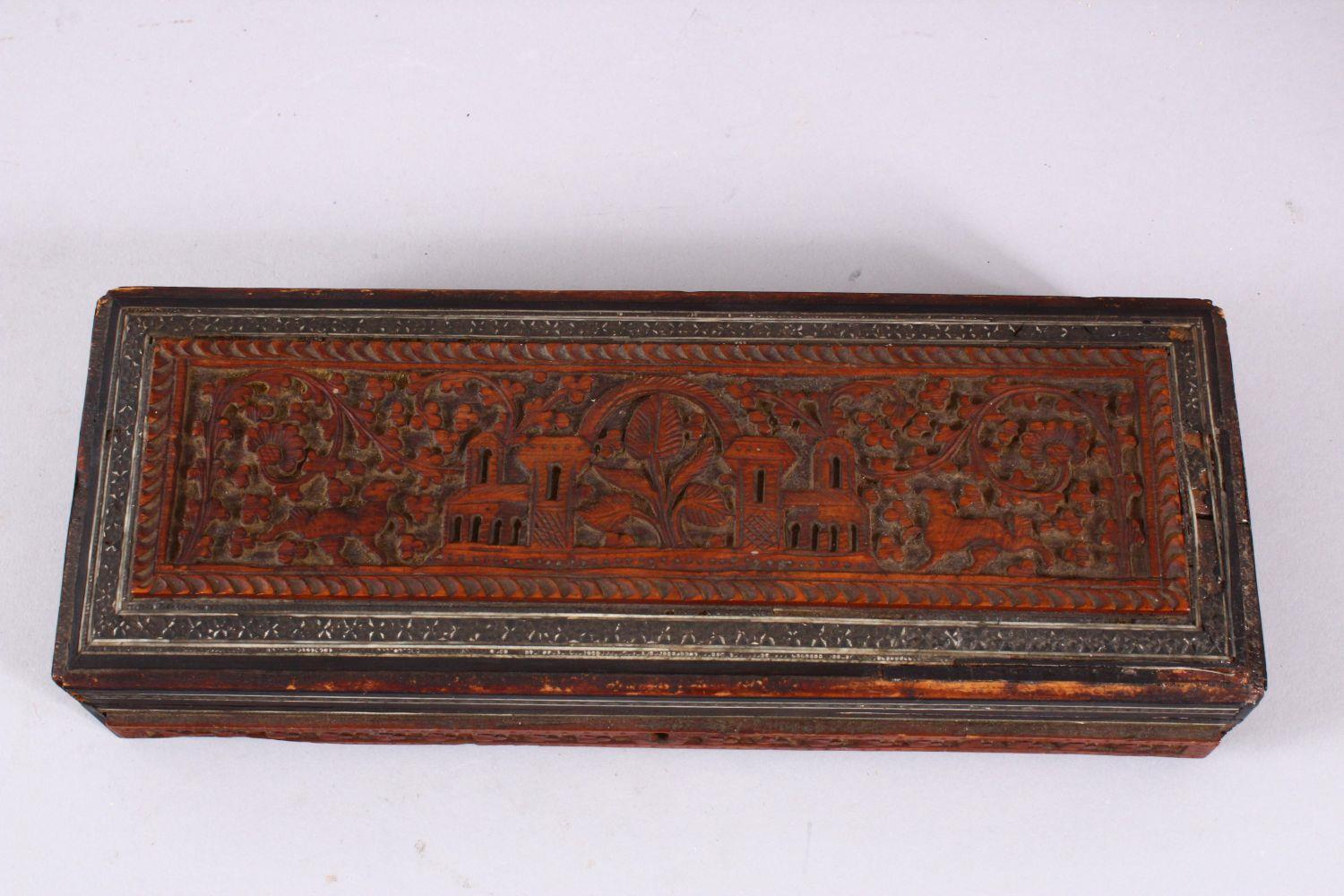 A 19TH / 20TH CENTURY INDIAN CARVED WOODEN BOX, carved with temples, animals and foliage, with - Image 2 of 4