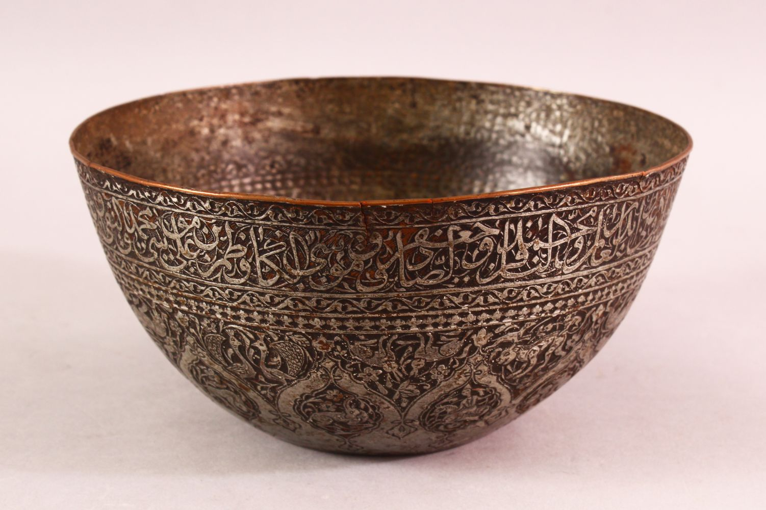 A GOOD ZANDI TINNED COPPER ENGRAVED CALLIGRAPHIC BOWL, with bands of calligraphy, 19cm diameter,