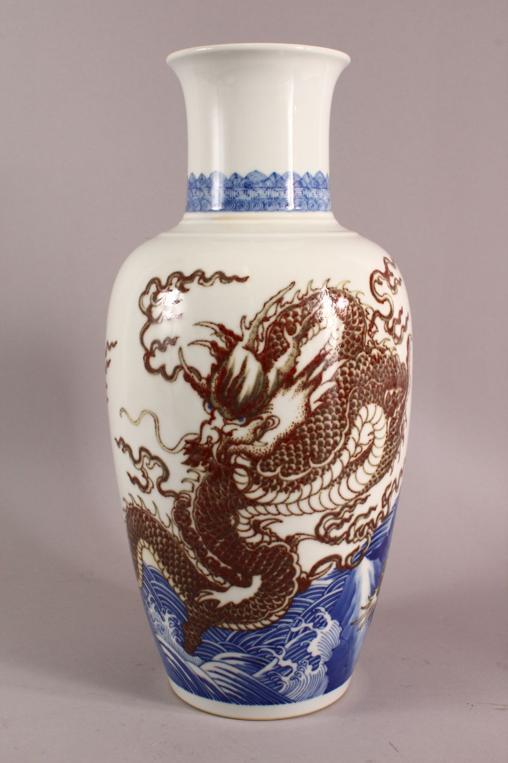 A LARGE CHINESE UNDERGLAZE BLUE & COPPER RED PORCELAIN VASE, decorated with dragons amongst waves, - Image 4 of 7