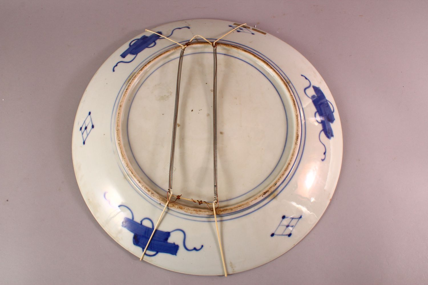 A LARGE JAPANESE POLYCHROME PORCELAIN CHARGER, depicting females in a garden setting, the - Image 5 of 5