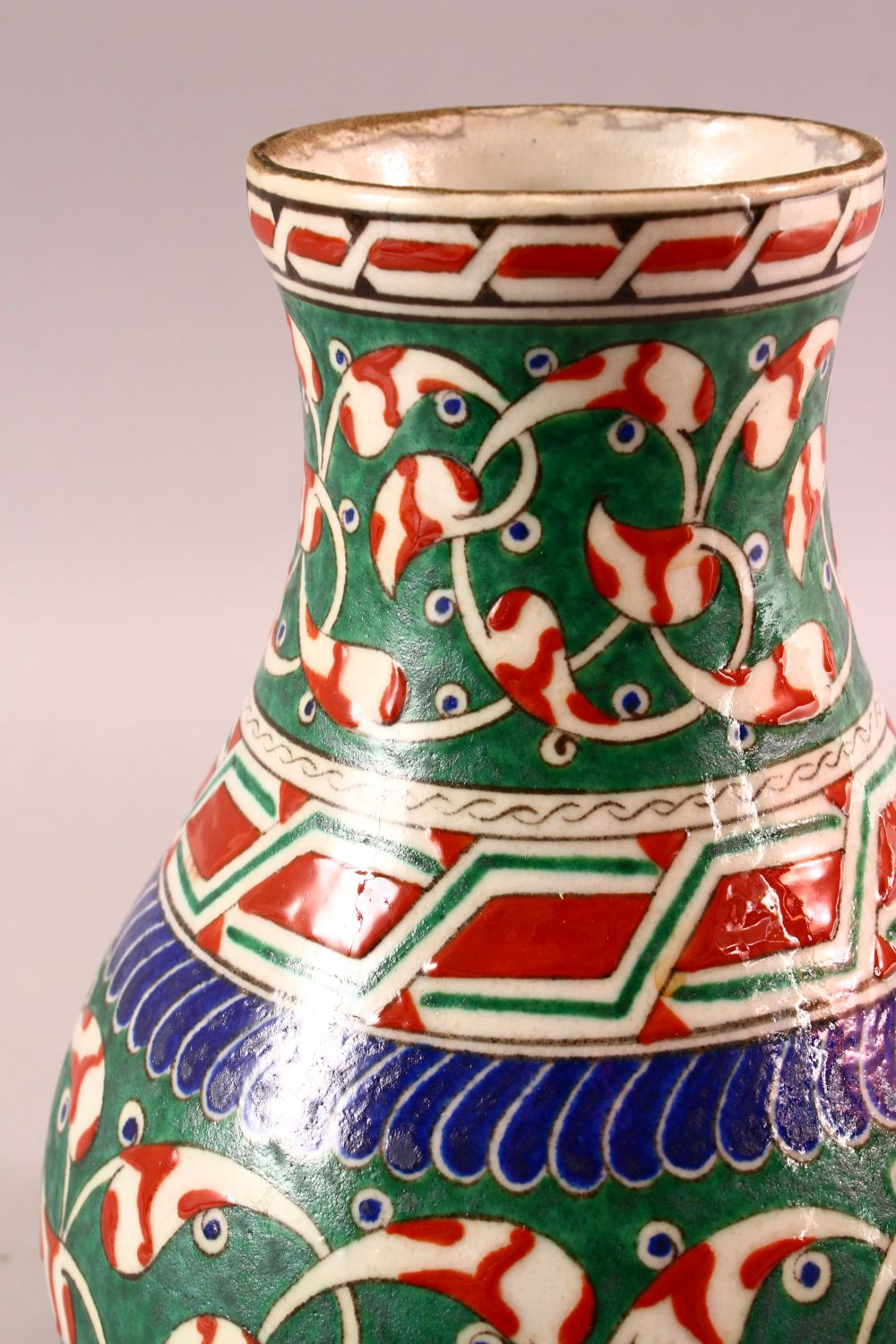 A TURKISH OTTOMAN 18TH CENTURY IZNIK VASE, with green and red motif decorations, 26cm - Image 2 of 4