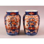 A PAIR OF JAPANESE MEIJI PERIOD PORCELAIN IMARI VASES, with ribbed body and floral panel decoration,