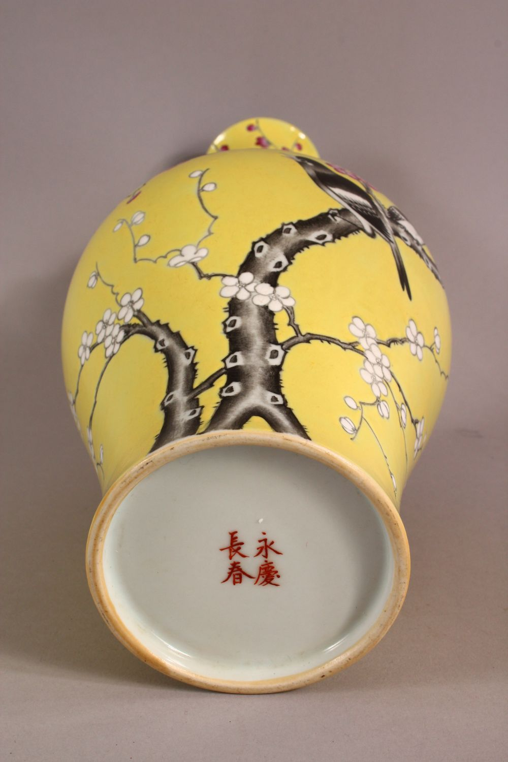 A CHINESE YELLOW GLAZED FAMILLE ROSE PORCELAIN VASE, decorated with birds in trees, with a mark - Image 8 of 9