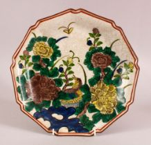 A JAPANESE KUTANI PORCELAIN CRACKLE WARE PLATE, with polychrome decoration of a bird and flora,