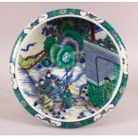 A CHINESE FAMILLE VERTE KANGXI STYLE PORCELAIN DISH, with figures on horseback in landscapes, the