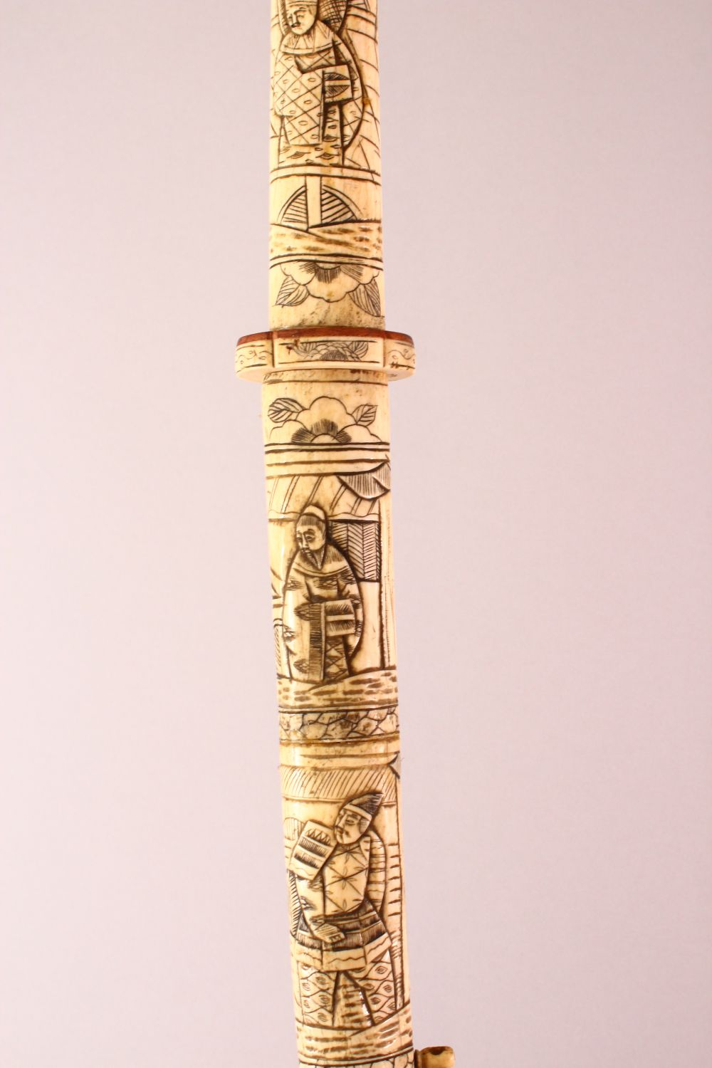 A JAPANESE MEIJI PERIOD SECTIONAL CARVED IVORY SWORD, carved with scenes of figures (AF) 85cm - Image 7 of 7